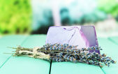 Piece of handmade soap with lavender oil, on bright background — Stock Photo