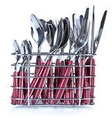 Kuchyňské příbory, nože, vidličky a lžíce v kovový stojan, izolované na bílém — Stock fotografie