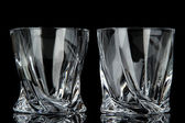 Empty glasses, isolated on black — Stock Photo