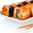 Stock Photo: Delicious sushi on plate and chopsticks isolated on white
