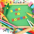 Small chalkboard with school supplies on white background. Back to School — 图库照片