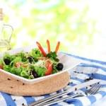 Light salad on plate on napkin on window background — Stock Photo #29092207