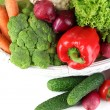 Fresh vegetables in white wicker basket close up — Stock Photo