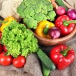 Fresh vegetables on burlap background — Stock Photo #29093035