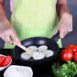 Stock Photo: Hands cooking marrows in pon gray background