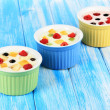 Delicious yogurt with fruit on table close-up — Stock Photo
