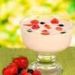 Delicious yogurt with fruit on table on bright background — Stock Photo