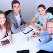 Stock Photo: Business team working on their project together at office