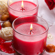 Beautiful red candles with flower petals in water — Stock Photo #29094477