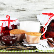 Yummy jam in banks on woven tray on napkin on wooden table on wooden background — Stock Photo #29094615
