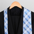 Suit and tie on hanger on gray background — Stock Photo #29095001