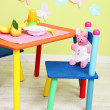 tasty baby fruit puree and baby bottle on table in room — Stock Photo #29095153