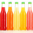 Stock Photo: Bottles with tasty drinks, isolated on white
