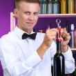 Bartender opens bottle of wine — Stock Photo #29097021
