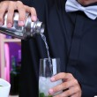 Portrait of handsome barman preparing cocktail, at bar — Stock Photo #29097027