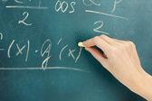 Math formula written on blackboard with chalk. — Stock Photo