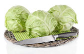 Cabbage on napkin on wicker tray isolated on white — Stock Photo