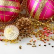 Beautiful pink Christmas balls and cones isolated on white — Stock Photo
