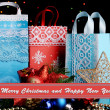 New Year composition of New Year's decor and gifts on  lights background — Stock Photo