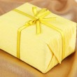 Romantic parcel on gold cloth background — Stock Photo #29128705