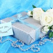 Romantic parcel on blue cloth background — Stock Photo