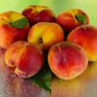 Peaches on metal green background — Stock Photo