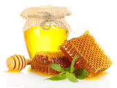 Sweet honeycombs, jar with honey and flowers, isolated on white — Stock Photo