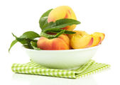 Ripe sweet peaches in bowl, isolated on white — Stock Photo