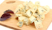 Tasty blue cheese on cutting board, isolated on white — Zdjęcie stockowe