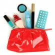 Stock Photo: Hormonal pills in women's make-up bag isolated on white