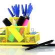Stock Photo: Office equipment in yellow stationary holder isolated on white
