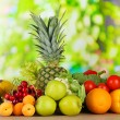 Assortment of fresh fruits and vegetables on natural background — Stock Photo