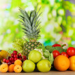 Stock Photo: Assortment of fresh fruits and vegetables on natural background