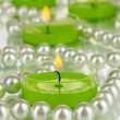 Stock Photo: Lighted candles with beads close up