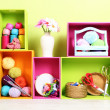 Colorful shelves of different colors with utensils on wall background — Stock Photo #29130805