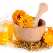 Medicine bottles and calendula flowers in wooden mortar isolated on white — Stock Photo #29130839