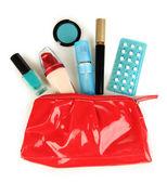 Hormonal pills in women's make-up bag isolated on white — Stock Photo