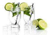 Glasses of cocktail with ice isolated on white — Stock Photo