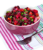 Beet salad in bowl isolated on white — Stock Photo
