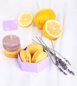 Macaroons on white cloth close-up — Stock Photo