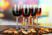 Glasses of liquors with almonds and coffee grains, on bright background — ストック写真
