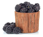 Sweet blackberries in wooden basket isolate on white — Stock Photo