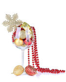 Wine glass filled with christmas decorations, isolated on white — Foto Stock
