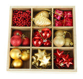 Wooden box filled with christmas decorations, isolated on white — Foto Stock