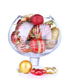 Glass bowl filled with christmas decorations, isolated on white — 图库照片