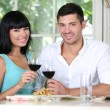 Beautiful young couple at restaurant — Stock Photo #29211187