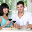 Beautiful young couple at restaurant — Stock Photo