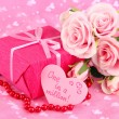 Romantic parcel on pink cloth background — Стоковая фотография