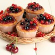 Tasty muffins with berries on white wooden table — Stock Photo