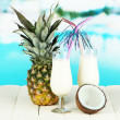 Pina colada drink in cocktail glasses, on bright background — Stock Photo #29252165